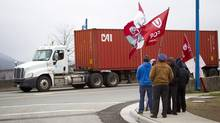 Truckers on strike picket at the entrance of Port Metro in Vancouver on March 18, 2014. (Ben Nelms for The Globe and Mail)