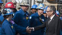 Natural Resources Minister Joe Oliver, right, greets workers at a Houston-based refinery owned by LyondellBasell Industries, which recently began processing 60,000 barrels a day of heavy oil from Alberta. (Patrick Schneider for The Globe and Mail)