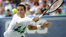 Milos Raonic reaches for the ball against Canadian compatriot Vasek Pospisil during the men's singles final at the Citi Open in Washington on Sunday. Raonic prevailed 6-1, 604 for the biggest singles victory of his career. (Nick Wass/the associated Press)
