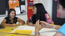 Grade 6 teacher Erin Hamilton, left, instructs Maneesha Johal, centre and Lee-Anna Maharaj, right on their EQAO standardized test prep at Lougheed Middle School in Brampton, Ont.,  May 16, 2013. (J.P. Moczulski For The Globe and Mail)