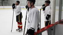 Calgary Flames' Matt Stajan, centre, looks during an informal skate in Calgary, Alta., Thursday, Jan. 10, 2013. (Jeff McIntosh/THE CANADIAN PRESS)