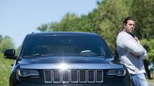 Montreal Alouettes lineman Josh Bourke and his 2014 Jeep Grand Cherokee SRT8. (Graham Hughes For The Globe and Mail)