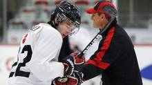 Team Canada's Brett Connolly gets a hand from head coach Don Hay during the Team White practice at the Canadian national junior hockey team selection camp practice in Calgary, Dec.11, 2011. (Todd Korol/Reuters/Todd Korol/Reuters)