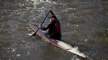 Garry Almond paddles along the Credit River in Mississauga on Tuesday. A day earlier, Mr. Almond was stopped by police and searched because they didn't want him paddling past a barbecue Prime Minister Stephen Harper was playing host to at a nearby park. (Moe Doiron/The Globe and Mail)