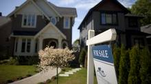 Real estate sign in the Kitsilano neighbourhood in Vancouver, British Columbia, Sunday, June 9, 2013. (Rafal Gersza For The Globe and Mai)