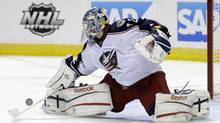 Columbus Blue Jackets goalie Sergei Bobrovsky, of Russia, deflects a shot on goal against the San Jose Sharks during the first period of an NHL hockey game in San Jose, Calif., Sunday, April 21, 2013. (Marcio Jose Sanchez/AP)