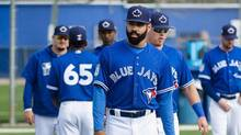 Toronto Blue Jays outfielder Dalton Pompey, left, stretches with teammates during baseball spring training in Dunedin, Fla., on February 19, 2017. (Nathan Denette/THE CANADIAN PRESS)