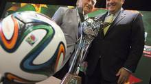 FIFA President Sepp Blatter laughs with CSA President Victor Montagliani (Peter Power/THE CANADIAN PRESS)