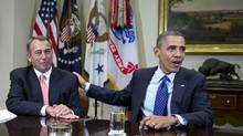 U.S. President Barack Obama acknowledges House Speaker John Boehner on Friday ahead of talks on resolving the fiscal impasse. (Carolyn Kaster/AP)