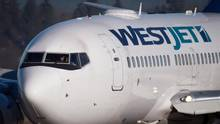 A Westjet Boeing 737-700 is shown on Feb. 3, 2014. (DARRYL DYCK/THE CANADIAN PRESS)