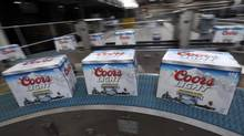 Boxed bottles of Coors Light beer, manufactured by Molson Coors Brewing Co., move along the production line ahead of shipping. (Chris Ratcliffe/Bloomberg)