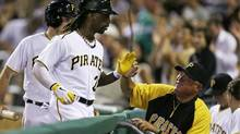 In photo taken July 13, 2013 Pittsburgh Pirates centre fielder Andrew McCutchen, left, is greeted by manager Clint Hurdle after hitting a solo home run during the sixth inning of a baseball game against the New York Mets in Pittsburgh, Saturday, July 13, 2013. (Gene J. Puskar/AP)