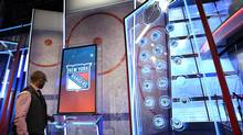 An interactive display that shows NHL team stats when a 'puck' is put into a special port. Rogers Sportsnet unveiled their new broadcast studio of the upcoming NHL hockey season, during a media tour at the CBC building in Toronto on Sept 29 2014. (Fred Lum/The Globe and Mail)