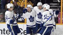 Toronto Maple Leafs players celebrate after a goal by Auston Matthews during the second period against the Nashville Predators at Bridgestone Arena in Nashville, on March 30, 2017. (Christopher Hanewinckel/USA Today Sports)
