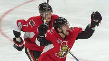 Ottawa Senators center Kyle Turris (7) and left wing Alexandre Burrows (14) celebrate their win in overtime against the Boston Bruins. The Senators defeated the Bruins 4-3 in game two of the first round of the 2017 Stanley Cup Playoffs at Canadian Tire Centre. (Marc DesRosiers/USA Today Sports)
