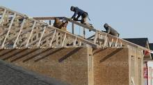 Crews work on a new housing development in Winkler, Manitoba Tuesday, November 26, 2013. Winkler has seen tremendous growth over the past 10 years. (JOHN WOODS/The Globe and Mail)