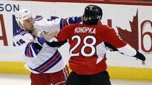 New York Rangers' Sean Avery (L) fights Ottawa Senators' Zenon Konopka minutes into the first period of their NHL hockey game in Ottawa November 9, 2011. (BLAIR GABLE/REUTERS)