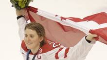 Pix from Canada's 2-0 victory over the USA in the gold medal game played at Canada Hockey Place in Vancouver during the 2010 Olympic Games. Canada's Hayley Wickenheiser with the flag. (Photo by Peter Power / The Globe and Mail) (Peter Power)