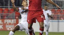 Canada's Dwayne De Rosario (in air) heads the ball against Panama's Amilcar Henriquez during their 2014 World Cup qualifying match in Toronto September 7, 2012. (MIKE CASSESE/REUTERS)