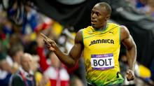 Jamaica's Usain Bolt wins gold in the 100m final at the 2012 Summer Olympics in London, England, Sunday August 5, 2012. (Kevin Van Paassen/The Globe and Mail)