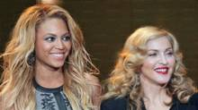 """Beyonce and Madonna at the taping of """"Oprah's Surprise Spectacular"""" in Chicago, May 17, 2011. (John Gress / Reuters)"""
