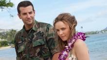 Bradley Cooper, left, and Rachel McAdams struggle with an overwritten screenplay in Cameron Crowe's latest, Aloha. (Neal Preston/AP)