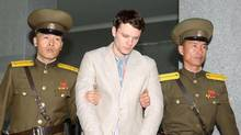 Otto Frederick Warmbier, centre, is taken to North Korea's top court in Pyongyang in this photo released by Kyodo on March 16, 2016. (KYODO/REUTERS)