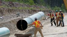 Workers construct the pipeline in Jasper National Park, Alta., as part of the Anchor Loop Project in 2007-08. (KINDER MORGAN CANADA)