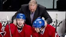 Montreal Canadiens Michel Therrien congratulates Alex Galchenyuk, left for his first NHL goal and teammate Brendan Gallagherfor his assist on the goal as they face the Florida Panthers during second period NHL hockey action Tuesday, January 22, 2013 in Montreal. (The Canadian Press)
