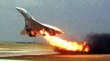 In this July 25, 2000 file photo, Air France Concorde flight 4590 takes off from Charles de Gaulle airport in Paris with fire trailing from the engine on its left wing. The subsequent crash killed 113 people. (Toshihiko Sato/AP)