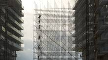 Workers install scaffolding during the ongoing construction at 25 Queen's Quay West in Toronto on December 31, 2013. (Peter Power/The Globe and Mail)