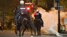 Police move in on protesters during a large demonstration designed as an act of defiance against a legal crackdown by the Quebec government, in Montreal, Friday, May 18, 2012. (Graham Hughes/Graham Hughes/THE CANADIAN PRESS)