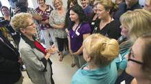 Premier Kathleen Wynne speaks to health care workers at a family health care unit on a campaign stop in Lindsay, Ont. on Friday, May 30, 2014. (Fred Thornhill/THE CANADIAN PRESS)