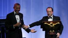 U.S. President Barack Obama and French President François Hollande share a toast during the State Dinner in honour of Hollande at the White House in Washington February 11, 2014. (KEVIN LAMARQUE/REUTERS)