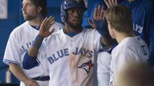 Toronto Blue Jays' Jose Reyes celebrates with teammates (Darren Calabrese/THE CANADIAN PRESS)