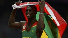 Grenada's Kirani James celebrates after winning the men's 400m final at the London 2012 Olympic Games at the Olympic Stadium August 6, 2012. (DYLAN MARTINEZ/REUTERS)
