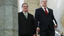 Finance Minister Jim Flaherty, left, has expressed doubts over Prime Minister Stephen Harper's 2011 election promise to allow income splitting. (BLAIR GABLE/REUTERS)