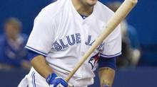Toronto Blue Jays' Dioner Navarro reacts after flying out against the Boston Red Sox during ninth inning AL baseball game action in Toronto on Monday, August 25, 2014. (Fred Thornhill/THE CANADIAN PRESS)