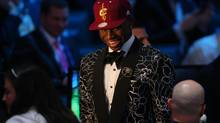 Andrew Wiggins (Kansas) walks off stage after being selected as the number one overall pick to the Cleveland Cavaliers in the 2014 NBA Draft at the Barclays Center. (Brad Penner/USA Today Sports)