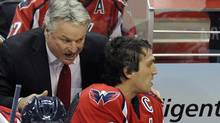 Washington Capitals head coach Dale Hunter, center, talks with Alex Ovechkin during the first period against the St. Louis Blues, Tuesday, Nov. 29, 2011, in Washington. (Nick Wass/Nick Wass/AP)