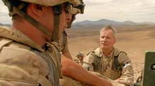 Brigadier-General Tim Grant visits with troops in Shah Wali Kot district north of Kandahar city in June 2007. (The Globe and Mail/Graeme Smith/)