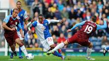 Blackburn Rovers' Junior Hoilett, center, is tackled by Aston Villa's Stiliyan Petrov, right, during the English Premier League soccer match at Ewood Park, Blackburn, England, Saturday March 3, 2012. The match ended in a 1-1 draw. (Clint Hughes/Associated Press)