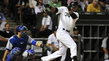 Chicago White Sox left fielder Alejandro De Aza (30) hits an RBI single against the Toronto Blue Jays during the fifth inning at U.S Cellular Field. (David Banks/USA Today Sports)