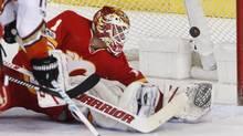 Anaheim Ducks' Patrick Eaves, left, scores against Calgary Flames goalie Brian Elliott in Calgary, Alta., Sunday, April 2, 2017. (Larry MacDougal/THE CANADIAN PRESS)
