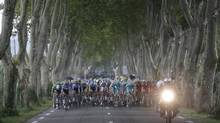 The peloton cycles its way during the 222-km, 15th stage of the Tour de France between Tallard and Nîmes on Sunday. (CHRISTIAN HARTMANN/REUTERS)