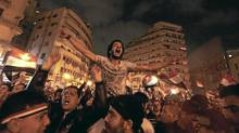 Anti-government protesters celebrate in Tahrir Square after the announcement of Egyptian President Hosni Mubarak's resignation in Cairo Feb. 11, 2011. A furious wave of protest finally swept Mubarak from power on Friday after 30 years of one-man rule, sparking jubilation on the streets and sending a warning to autocrats across the Arab world and beyond. (DYLAN MARTINEZ/REUTERS)