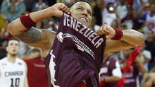 Venezuela's Rafael Perez celebrates after defeating Canada during their FIBA Americas Championship basketball game in Caracas September 6, 2013. (CARLOS GARCIA ROLINS/REUTERS)