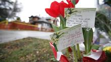 Flowers at the murder scene at 1702 De Sousa Place in Victoria, BC, where 24-year-old real estate agent Lindsay Buziak's body was found February 2009. (Deddeda Stemler/Deddeda Stemler/ The Globe and Mail)