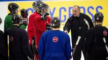 Team Canada players listen to head coach Brent Sutter during practice at the IIHF World Junior Hockey Championships in Malmo, Sweden on Wednesday January 1, 2014. (FRANK GUNN/THE CANADIAN PRESS)