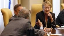 Quebec Premier Pauline Marois listens to Deputy Premier Francois Gendron. (MATHIEU BELANGER/REUTERS)